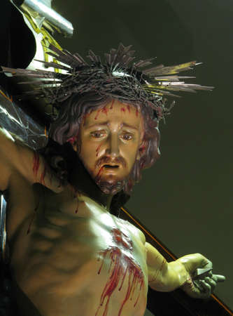 flagellation: A detail of the crucified Jesus in Cospicua, Malta.