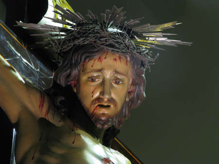 scourging: A detail of the crucified Jesus in Cospicua, Malta.