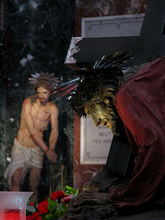 flagellation: A statue of Jesus under the cross in the foreground and another statue of The Flagellation of Jesus in the background