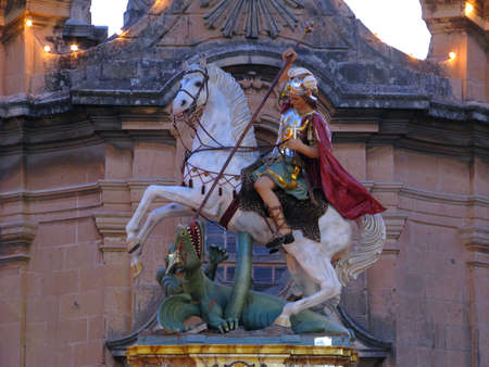 slayer: A paper mache statue of Saint George which forms part of a number of street decorations for the feast of the same saint in Qormi, Malta.