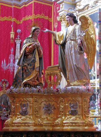 A statue of The Annunciation of Our Lord Jesus to The Blessed Virgin Mary by the Angel Gabriel in Balzan, Malta  photo