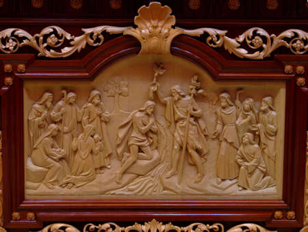 bass relief: A bass relief in wood depicting The Batism of Jesus in Marsa, Malta  Stock Photo