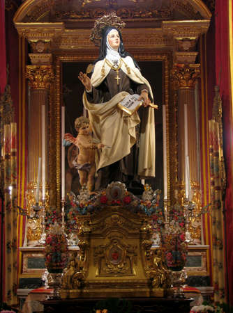 carmelite nun: A statue of Saint Teresa of Avila in Cospicua, Malta  Editorial