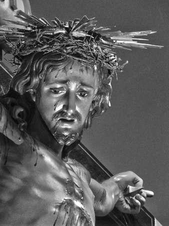scourging: A detail of the crucified Jesus from a group of statues depicting The Crucifixion in Cospicua, Malta  Stock Photo