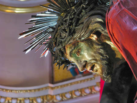 scourging: A detail of the statue of Jesus when He fell under the cross in Senglea, Malta  Stock Photo