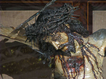 scourging: A detail of a statue of the crucified Jesus at Valletta, Malta  Stock Photo