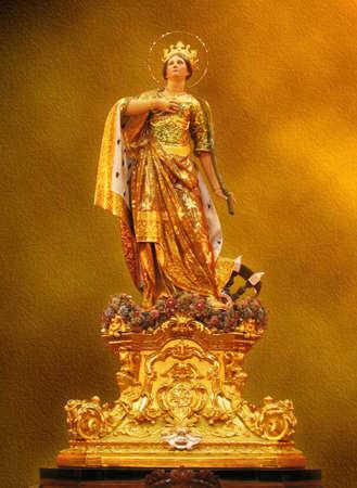 A statue of Saint Catherine at Zurrieq, Malta  photo