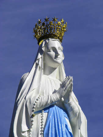 our lady: A detail of the beloved statue of Our Lady of Lourdes at Lourdes, France.