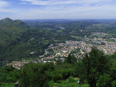 parish: The city of Lourdes, so called The city of Our Lady, as seen from the Pyrenees mountains in Lourdes, France.