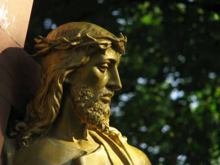 crucis: A detail of a statue of Jesus Christ which forms part of a group of statues representing the 8th Station of the Cross at Lourdes, France.