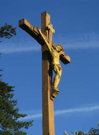 crucis: A Cross at the beginning of the Via Crucis or The Way of The Cross at Lourdes, France. Stock Photo