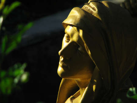 A detail of the statue of Our Lady of Sorrows that forms part of a group of statues representing the 4th Station of the Cross at Lourdes, France. Stock Photo