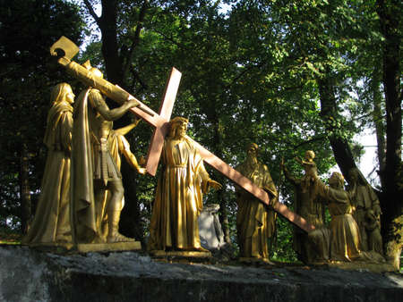 A group of statues representing the 8th Station of the Cross at Lourdes, France. Stock Photo