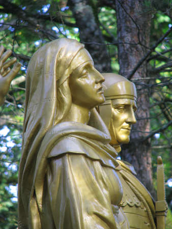 our lady of sorrows: A detail of the statue of Our Lady of Sorrows that forms part of a group of statues representing the 10th Station of the Cross at Lourdes, France.