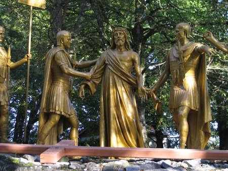 A group of statues representing the 10th Station of the Cross at Lourdes, France.