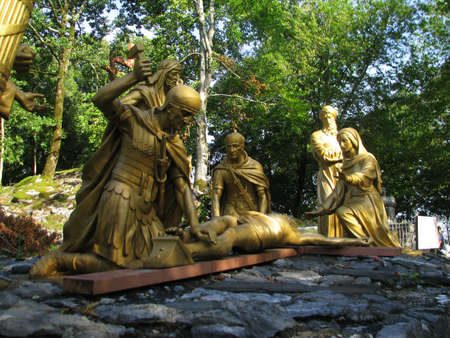 A group of statues representing the 11th Station of the Cross at Lourdes, France.