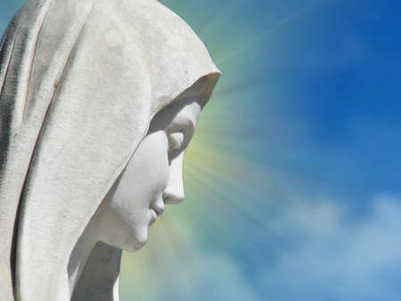 A detail of a marble statue of Our Lady Queen of Peace in Medjugorje, Bosnia-Herzegovina.