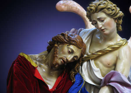 comforted: A detail of a statue of Jesus being comforted by an angel while He was praying in the Garden of Gethsemane.