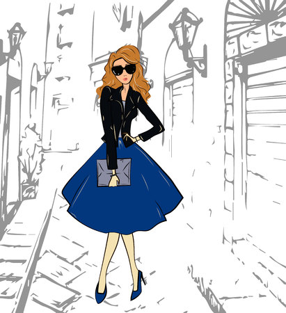 Fashionable cute girl in a leather jacket, blue midi skirt and shoess walking down the street