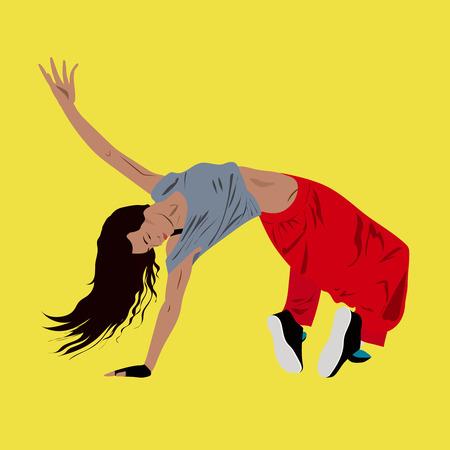 Young woman dancing hip-hop or break-dance on the floor,yellow background