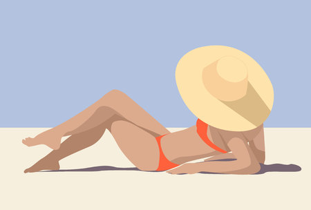 Girl in the hat on the sunny beach sunbathing