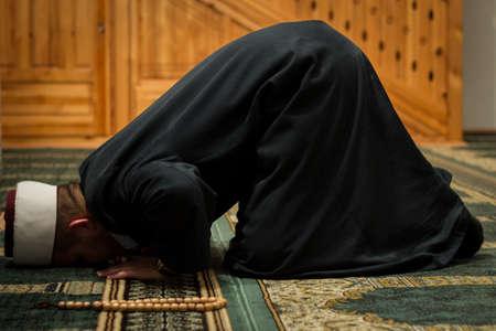 Imam praying Stok Fotoğraf