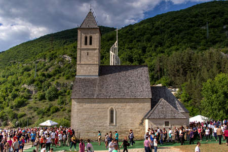 religious event: Jajce-Podmilacje, Bosnia and Herzegovina - June 23, 2015: Pilgrims on traditional religious event St. Ivo Sveti Ivo in church in Central Bosnia.