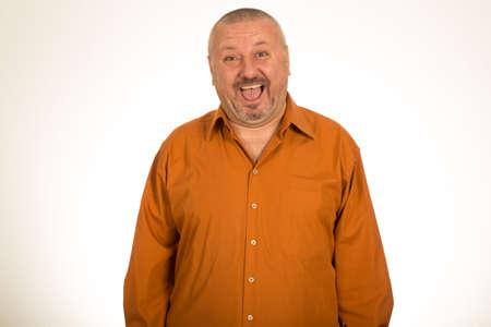 hombre con barba: Portrait of a fat man smiling isolated on white background Foto de archivo