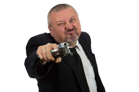 pointing gun: Middle aged businessman pointing gun isolated on white background