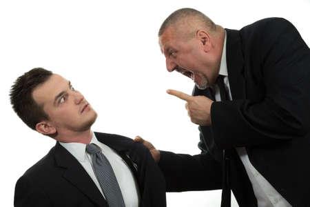 fighting: Empresario gritando y luchando a una joven colega aislado en blanco Foto de archivo
