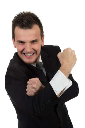 Portrait of young businessman in suit pointing at you isolated over white background