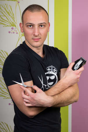 hair stylist: Hair stylist holding in hand scissors and hairdresser equipment.
