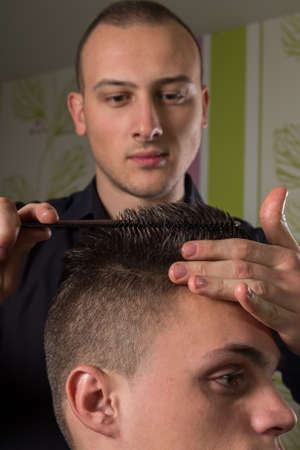 beauty parlor: mens hair cutting with comb and scissors in a beauty salon Stock Photo