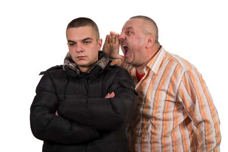 reprimand: Father and son having an argument isolated on white background