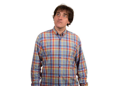 conceived: Closeup portrait of pensive young man in checkered shirt. Isolated on white background. Stock Photo