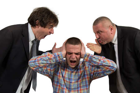 Young man being yelled at by two senior male manager on white.