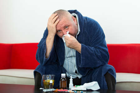 Adult man patient with cold and flu illness relief Banco de Imagens