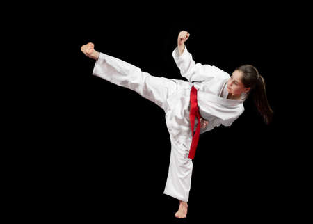 Young girl preforming karate martial arts. Banco de Imagens