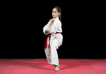 sensei: Young girl preforming karate martial arts. Stock Photo