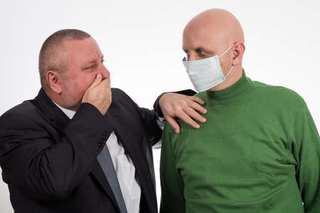 Businessman comforting young man suffering from cancer Archivio Fotografico