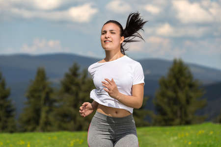 young woman jogging in nature.
