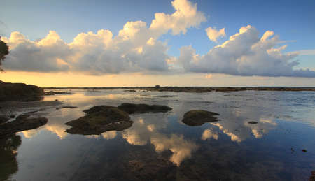 Clouds reflection at Tip of Borneo ocean, Simpang Mengayau, Kudat, Malaysia photo