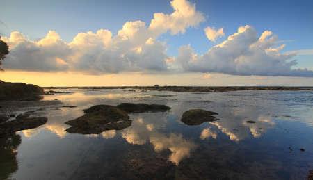 Clouds reflection at Tip of Borneo ocean, Simpang Mengayau, Kudat, Malaysia photo