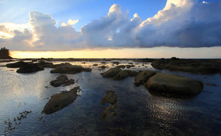 Ocean rippling water and sunset at Tip of Borneo, Simpang Mengayau, Sabah, Malaysia photo