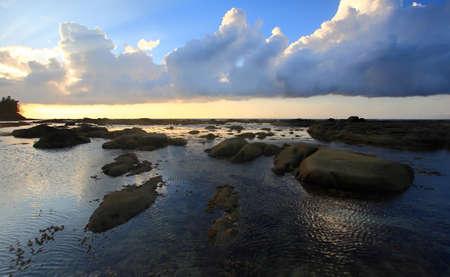 Ocean rippling water and sunset at Tip of Borneo, Simpang Mengayau, Sabah, Malaysia photo