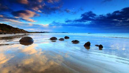 natural phenomena: Beautiful morning reflection at Moeraki Boulders, South Island of New Zealand Stock Photo