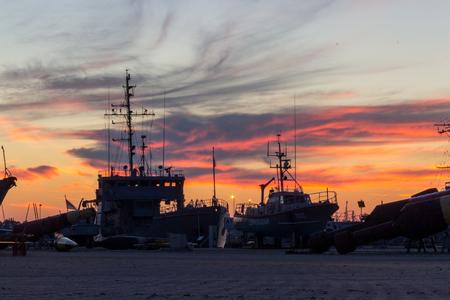 wharf: tainn port at sunsett .baltic sea estonia