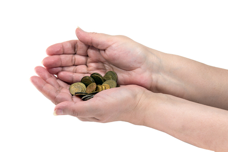 A small palm of coins in the hands of a pensioner Stock Photo