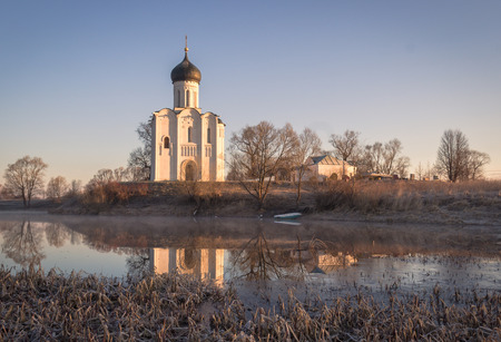 nerl: Ancient white church on the shore of the lake in the frosty dawn