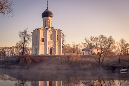nerl: View to the Church of the Intercession of the Holy Virgin on the Nerl River in sunlight Stock Photo